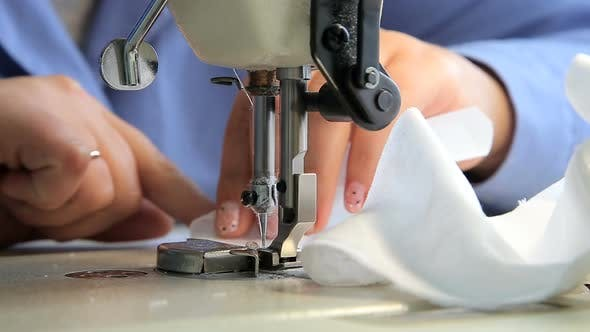 Seamstress at Work By the Sewing-machine