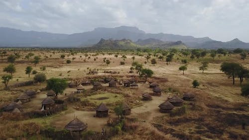 Aerial above an authentic Village With homes made from wood and straw in Uganda, East Africa