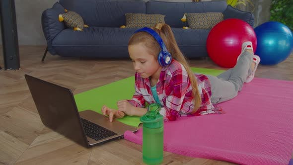 Relaxed Adorable Girl in Headphones Working on Laptop
