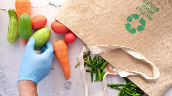 Recycled Arrows Sign on a Shopping Bag with Vegetable