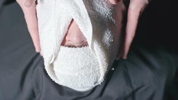 Thumbnail for Putting Hot Towel Before Shaving Beard