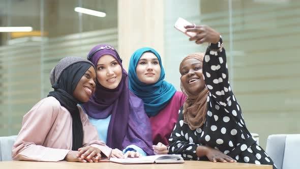 Thumbnail for Muslim Multiracial Student Girls in Hijabs Taking Selfie at University Hall