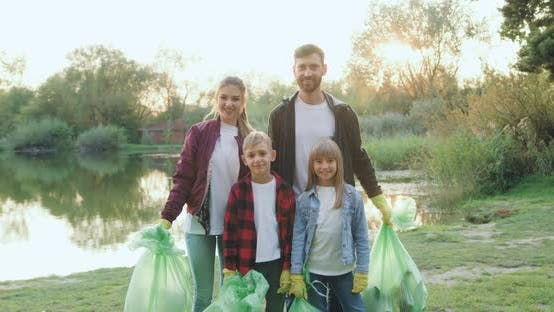 Thumbnail for Family Standing in Front of Camera with Rubbish Bags After Cleaning Lake's Territory