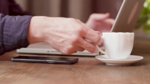 Thumbnail for Man Drinks Coffee and Uses His Smartphone To Pay for It