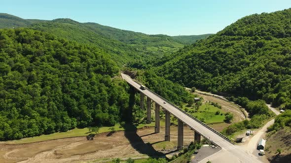 Thumbnail for Bridge In Caucasus With Truck And Greenery Around