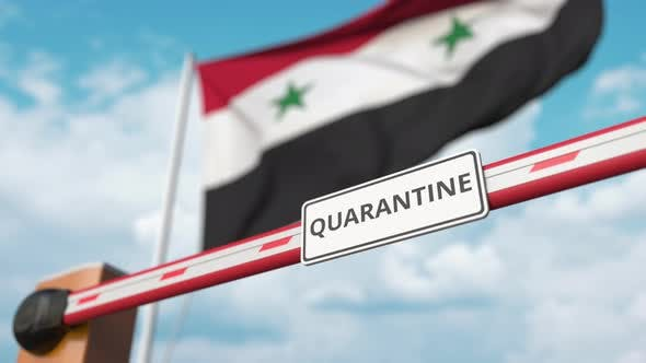 Open Boom Gate with QUARANTINE Sign at the Syrian Flag