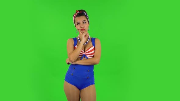 Thumbnail for Beautiful Girl in a Swimsuit Is Waiting with Boredom. Green Screen