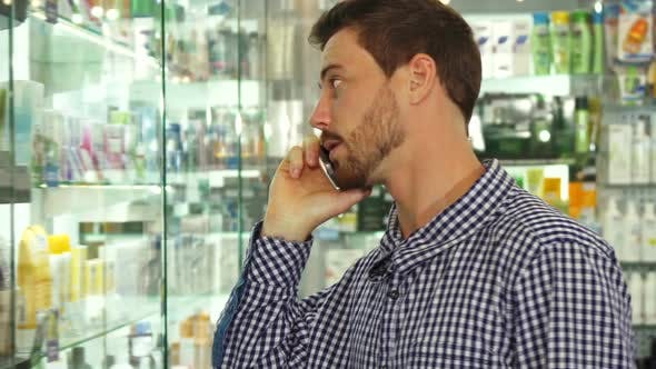 Thumbnail for Man Talking on Phone About Pills in Drugstore