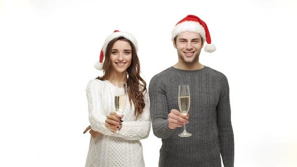 Thumbnail for Slow-motion Young Couple Enjoy Drinking Champagne Celebrate for Christmas Fun Together Feeling