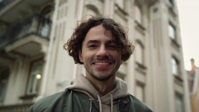 Cheerful Man Smiling on Urban Street