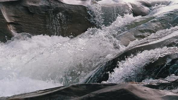 Thumbnail for Wild Mountain River Flowing with Stone Boulders and Stone Rapids. Slow Motion