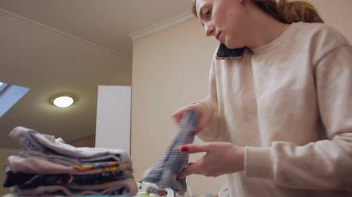 The Housewife Folds Clothes