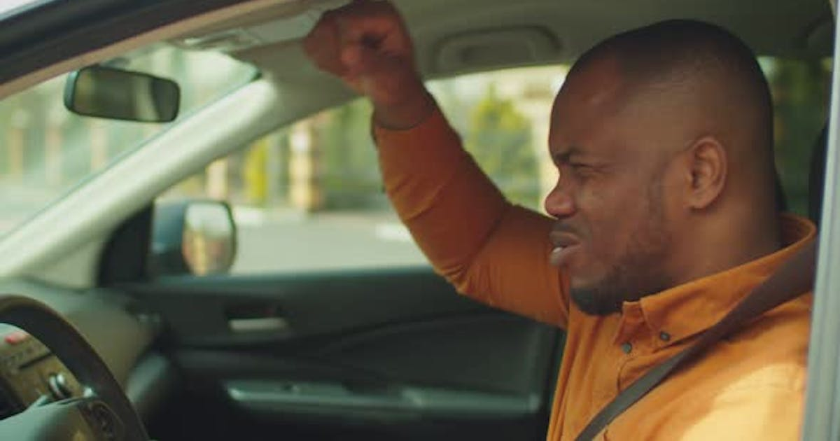 Angry Man Driver Hitting Steering Wheel with Fists
