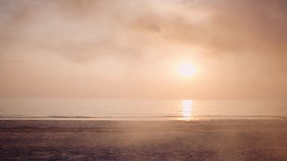 Thumbnail for Wide Shot of Cinematic Sunrise at Seashore at Early Morning