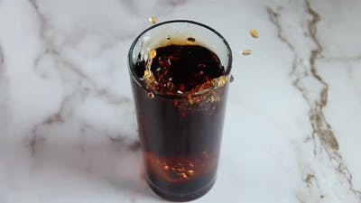 Ice Cube Falls Into the Cola