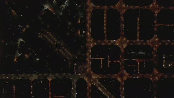 Thumbnail for AERIAL: Barcelona Overhead Drone Shot of Typical City Blocks at Night with Beautiful City Traffic