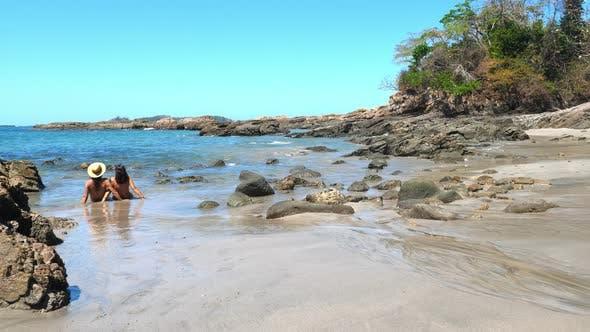 Thumbnail for Couple Sunbathing on a Virgin Tropical Beach