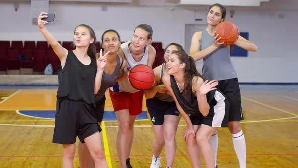 Thumbnail for Young Female Basketball Team Taking Selfie with Smartphone