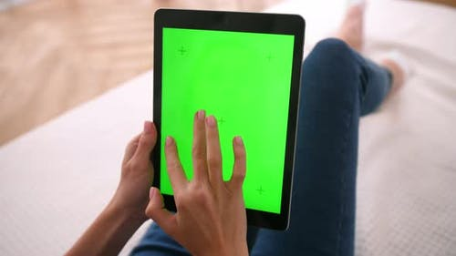 Woman Touches Swipes and Zooms Green Screens