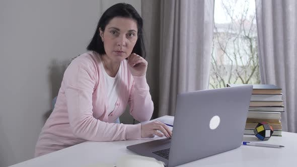 Thumbnail for Nervous Caucasian Young Woman Looking at Screen, Hearing Something, Closing Laptop and Leaving