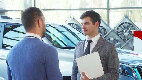 Thumbnail for A Representative Seller Gives the Car Keys To the Buyer