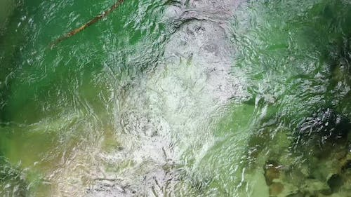Top view of a waterbody with a clear water in a green coloration