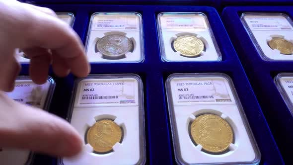 Thumbnail for Man Examining Collection Of Coins