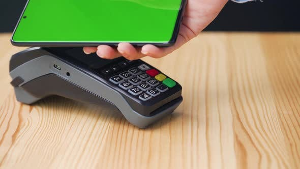 Thumbnail for Contactless Payment with Your Smartphone with Green Mock-up Screen. Wireless Payment Concept. Close