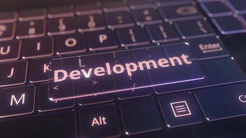 Futuristic Computer Keyboard and Transparent Development Key