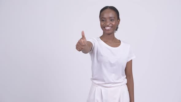 Thumbnail for Happy Young Beautiful African Woman Giving Thumbs Up