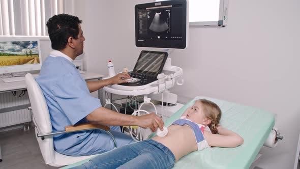 Thumbnail for Little Girl Having Ultrasound Scan