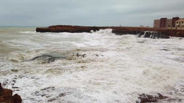 Thumbnail for Slow Motion of a Strong and Powerful Sea Wave Crashing Against a Rocky Shore with Large Rocks.