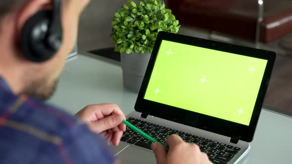 Thumbnail for Closeup Freelancer Male Hands Using Green Screen Chroma Key Laptop Typing Working Light Office