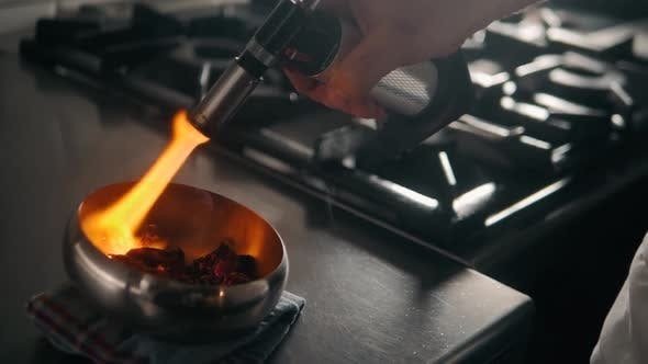 Thumbnail for Red Chili Peppers and Herbs Spices with Fire on Modern Kitchen in Restaurant
