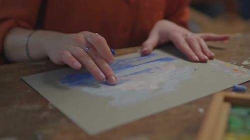 Artist Hand Creating Picture with Pastel Crayon