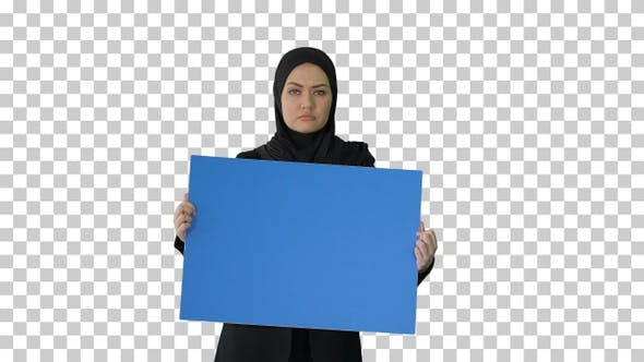 Serious Arab woman in hijab holding blank, Alpha Channel