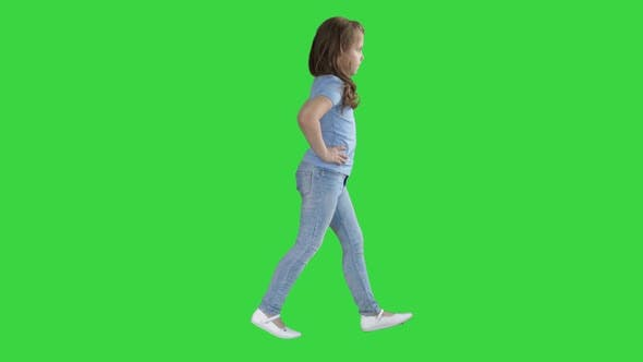 Cover Image for Little Girl in Casual Clothes Walking on a Green Screen, Chroma Key