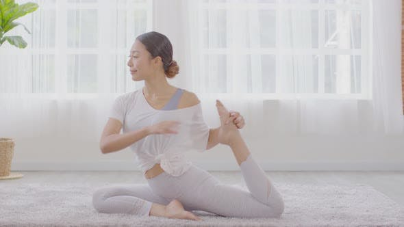 Side view of Asian woman doing Yoga exercise