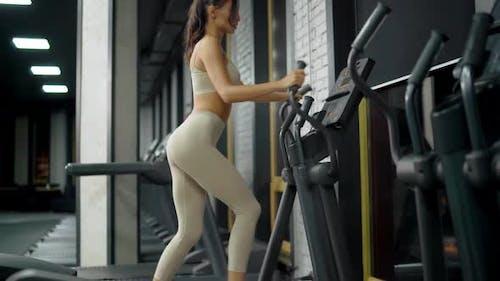 Sportswoman Running on Orbitrek.