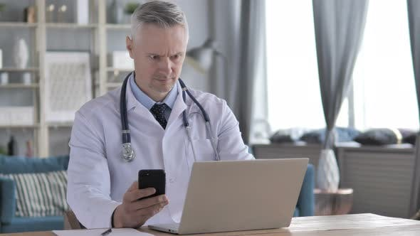 Thumbnail for Doctor Working on Laptop and Using Smartphone in Clinic