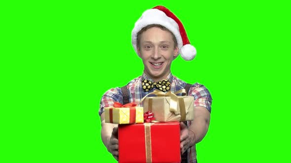 Teenage Boy with Gift Boxes for Xmas