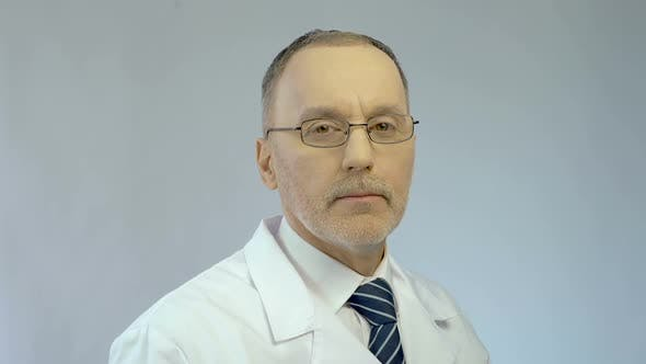 Thumbnail for Experienced Chief Physician Turning Face to Camera, High Quality Medical Care