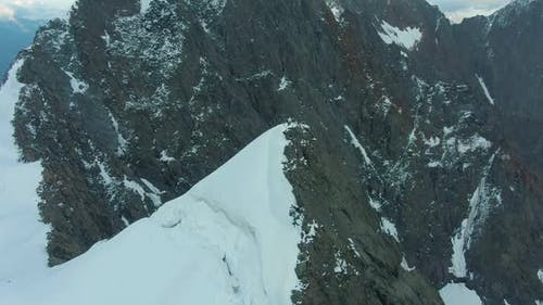 Top of Snow-Capped Mountain in European Alps. Aerial View