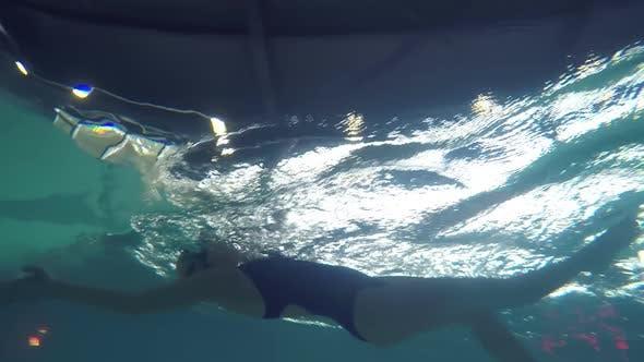 Thumbnail for Female Swimmer Practicing Backstroke