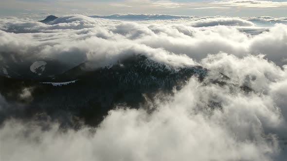 Thumbnail for Foggy Morning Above Clouds Moving in Winter Mountains Landscape
