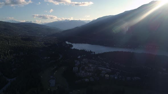 Sun Flare Aerial Of Golf Course And Alta Lake At Whistler Canada