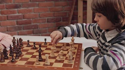 Two Boys Playing Chess