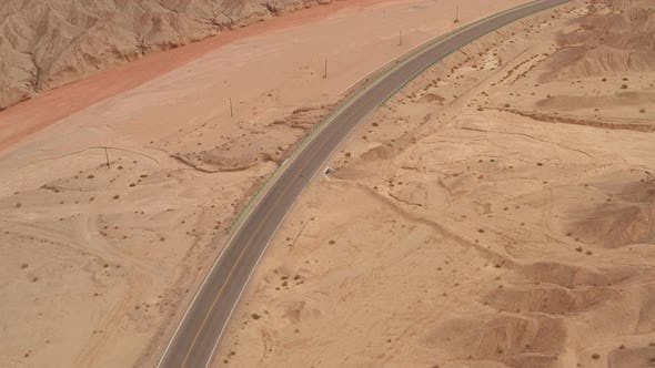 Thumbnail for Dryness land with erosion terrain with highway crossing
