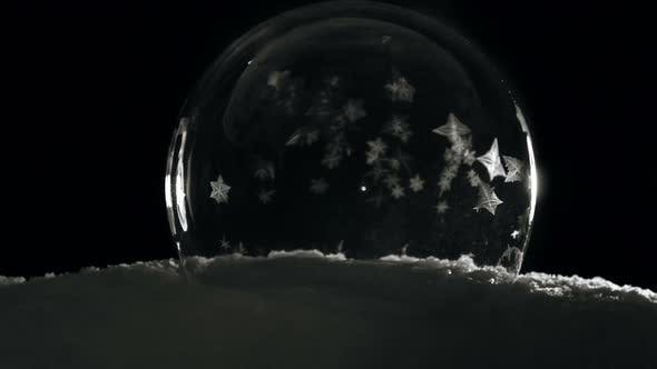 Cover Image for Ice Globe Freezing in Cold Winter Morning on Black Background