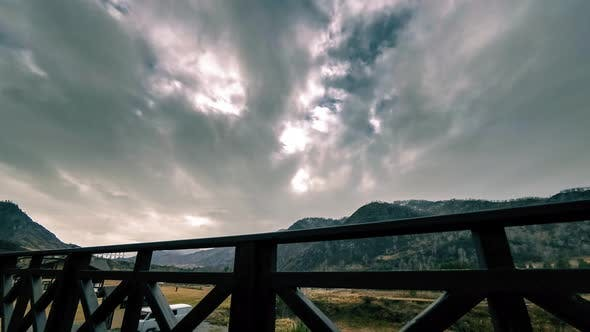 Thumbnail for Timelapse of Wooden Fence on High Terrace at Mountain Landscape with Clouds. Horizontal Slider